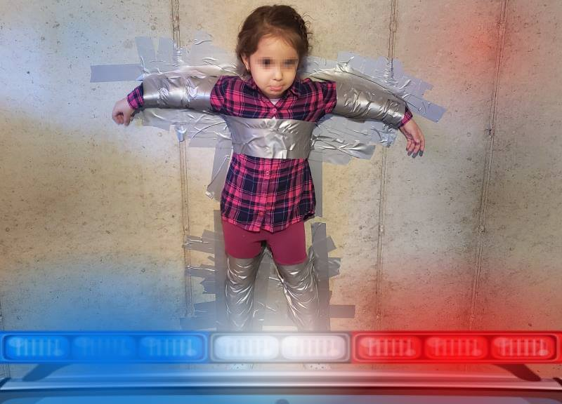 Little Girl Taped To A Wall